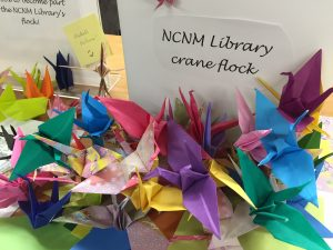 pile of multicolored origami cranes